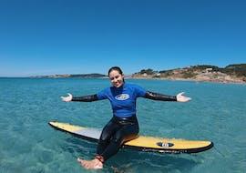 A woman enjoys her surfing lessons on La Lanzada beach with Waipia Surf School O Grove.