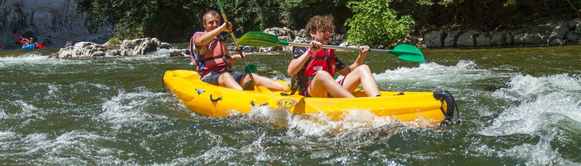 Two young boys having fun on a 12km Canoe Hire in Ardèche - Maxi-Tour provided by Viking Bateaux.