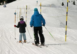 Ski instructor takes his student over the practice slope during Private Ski Lessons for Kids - All Levels with the ski school Freedom Snowsports.