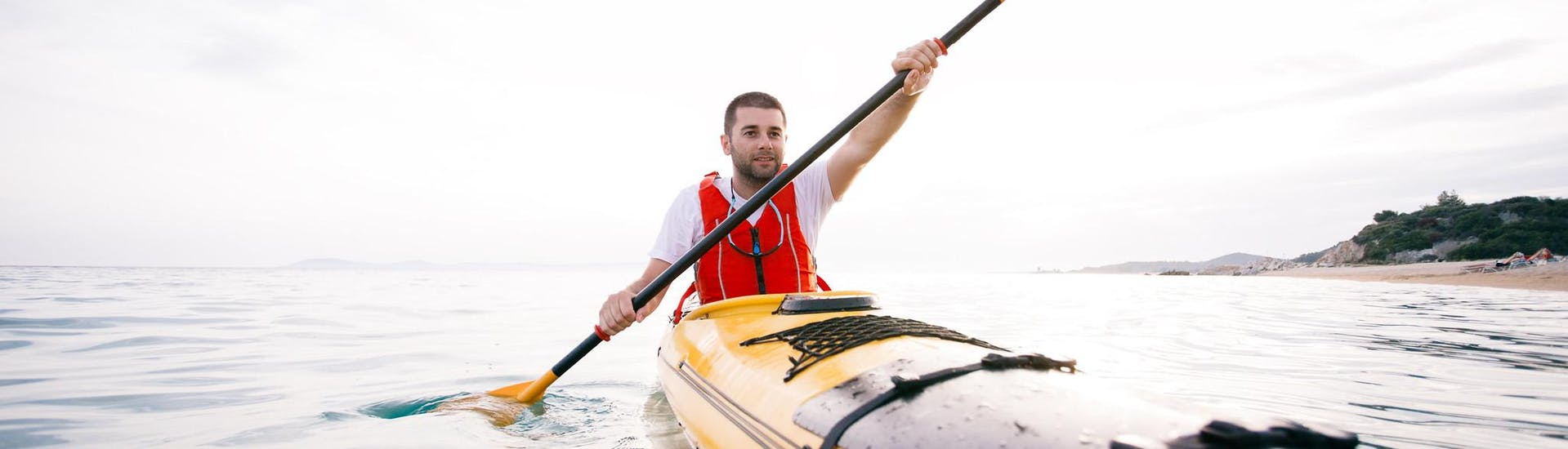 A person is paddling around and enjoying his day on the water with his kayak rental in Cullera from Anywhere Watersports.