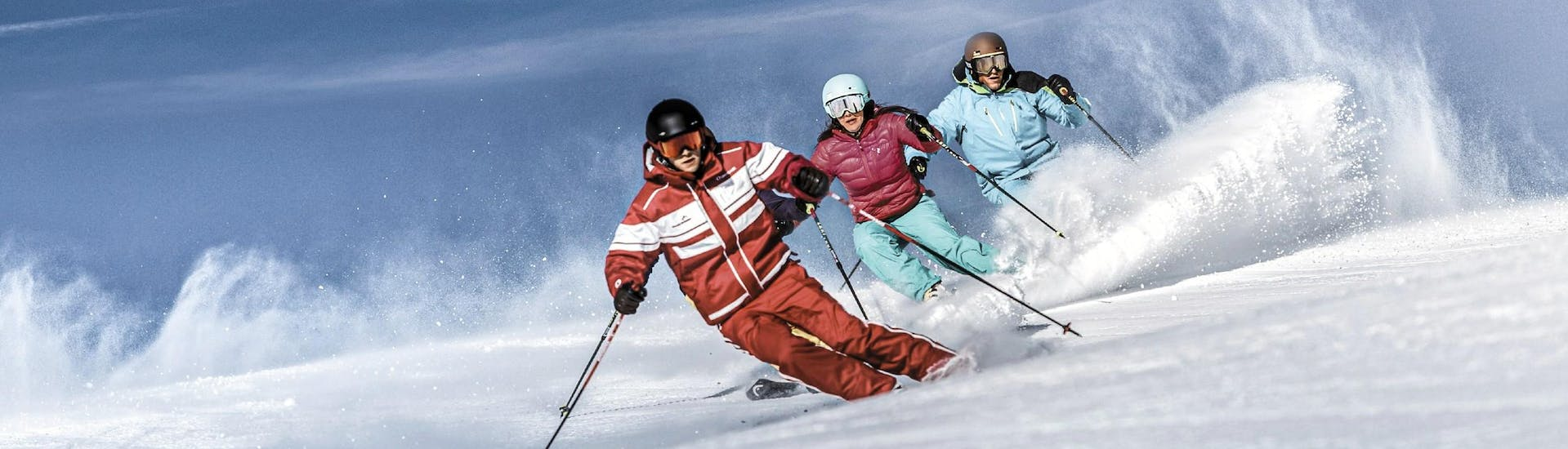 During the Adult Ski Lessons for All Levels with Skischule Schruns, the participants practice their carving technique with the help of an experienced ski instructor.