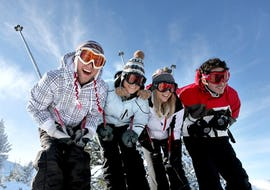 Adults are smiling into the camera in the Ski Lessons for Adults - All Levels