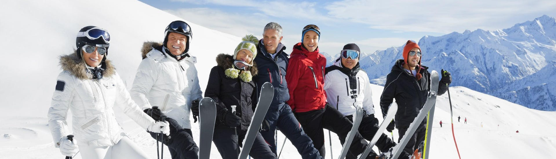 A group of skiers enjoying one of the many ski lessons for adults in the ski resort of Méribel.