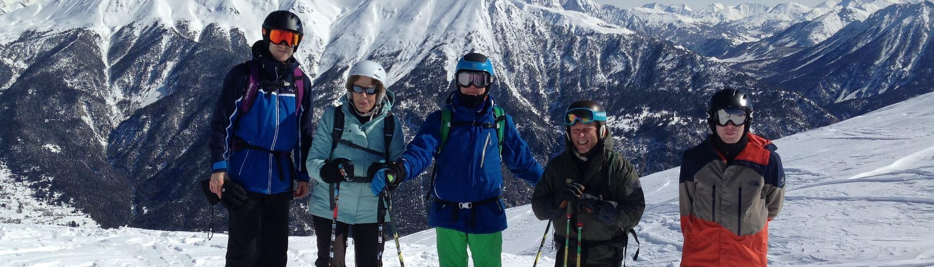 """Adults pose for the picture in the mountains in the Ski Lessons """"All-in-One"""" for Adults - Advanced"""