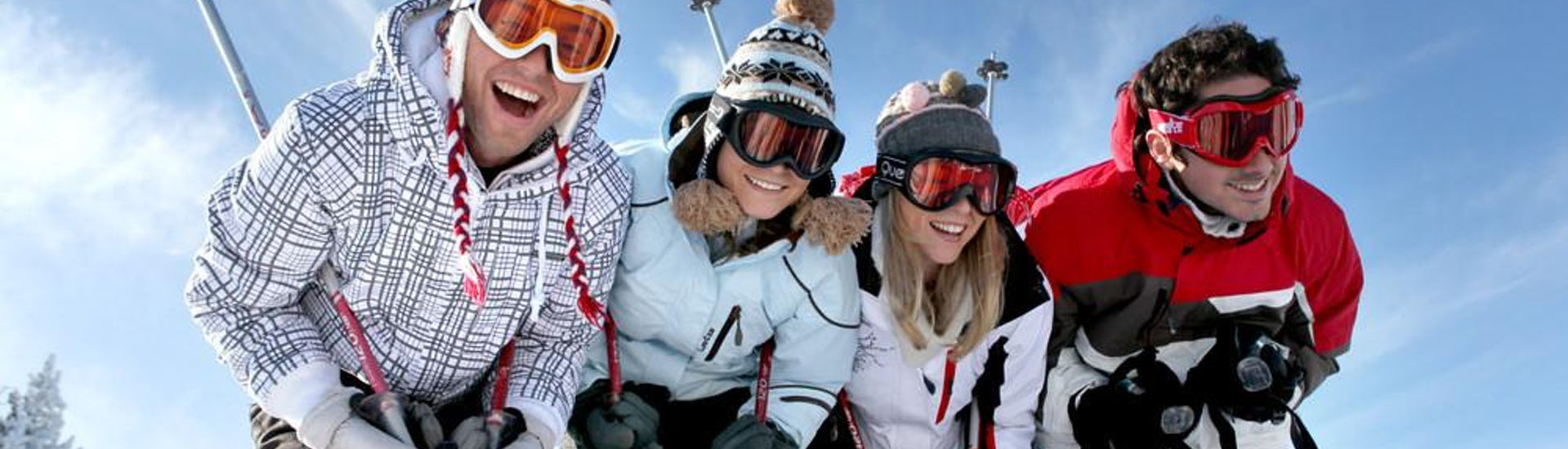 Adult ski group smiling to the camera