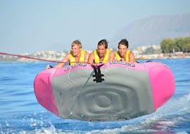 A group of friends is enjoying their Airstream Ride in Agia Marina activity with Cactus Water Sports Center.
