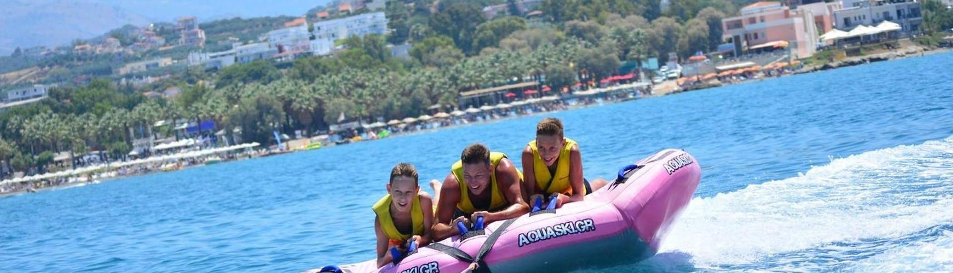 A family is having fun during the Airstream Ride in Agia Marina activity with Cactus Water Sports Center.