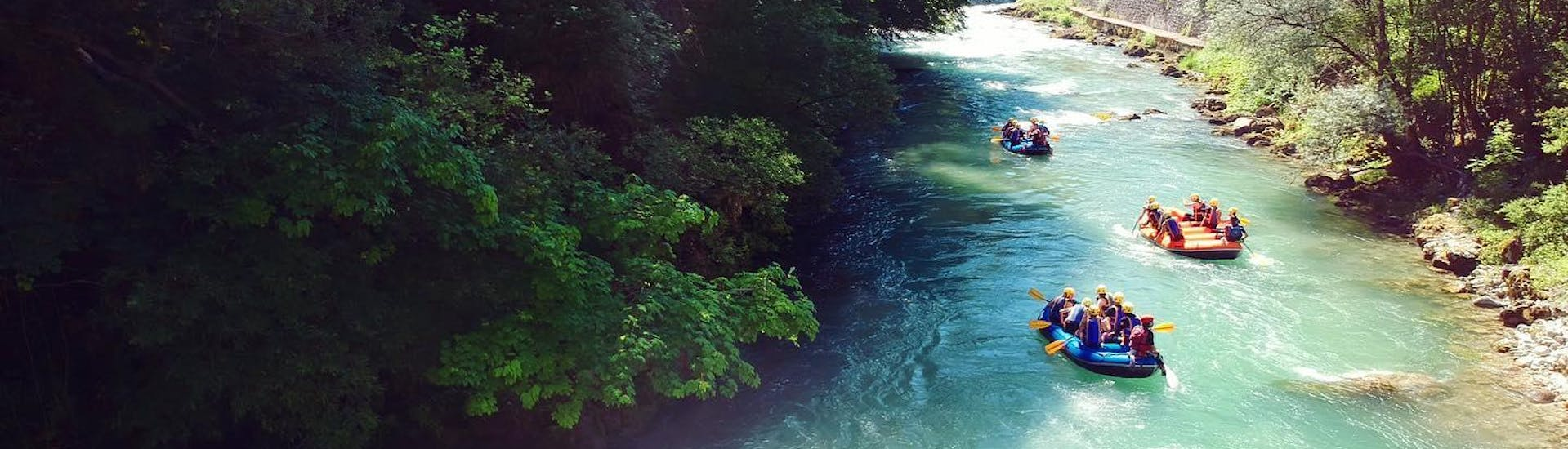 A group is doing a rafting tour on the Dranse River with AN Rafting Haute-Savoie