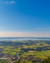 The view from above from the Chiemsee in an hot air balloon that you will have during your ballooning flight.