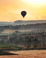 A sunset photo above the fields of a ballooning flight in Mallorca.