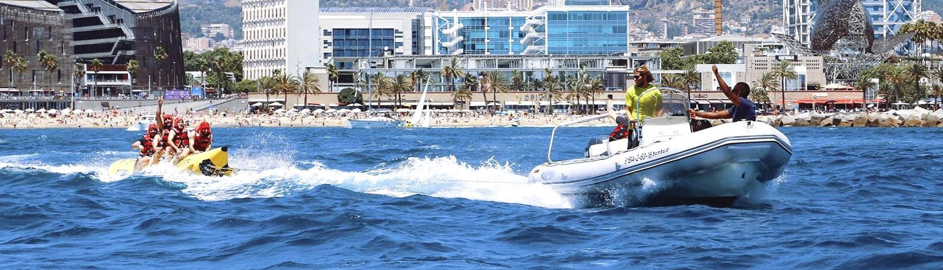 Experienced staff from Five Star Barcelona is towing a group of friends during the Banana Boat Ride - Barcelona.