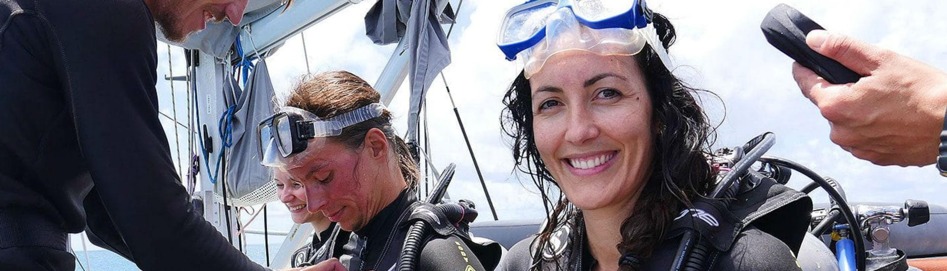 A group of scuba divers is preparing to get into the water for some Beginners' Scuba Diving at the Great Barrier Reef with Ocean Free.