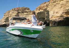 A group of women is relaxing on the Seasiren Tours motor boat during their Boat Tour - Algarve.