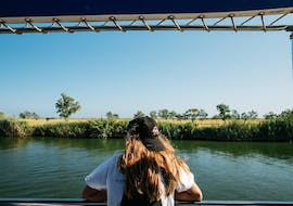 A woman enjoys the indescribable view during the Boat Tour at the Ebro Delta River organized by Estació Nàutica Costa Daurada.