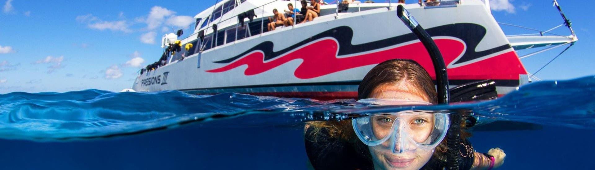 A young woman is exploring the marine wonderland during the Boat Tour with Snorkeling on the Great Barrier Reef organised by Passions of Paradise.