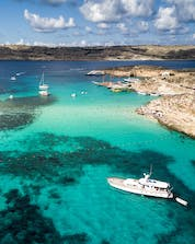 An aerial view of the crystal clear waters you can witness on a boat tour to the Blue Lagoon on Comino.