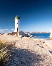 An image of the light house at Punta Sardegna, as can be seen by those who join a boat trip in Palau.