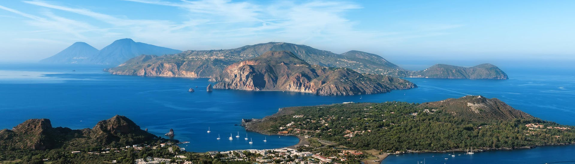 An image of the majestic volcanoes that one can see on a boat trip to the aeolian islands.