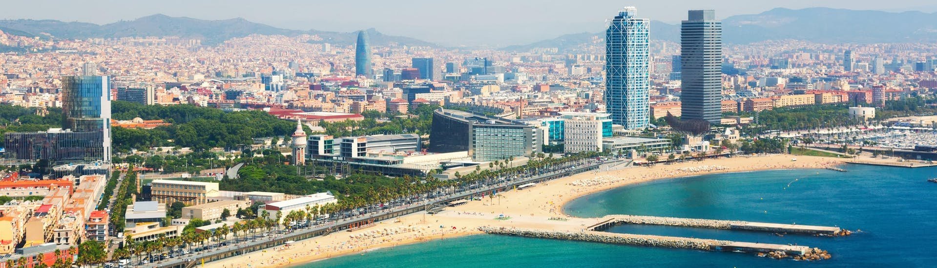 An aerial view of the Barcelona waterfront that you can see on a boat trip in Barcelona.
