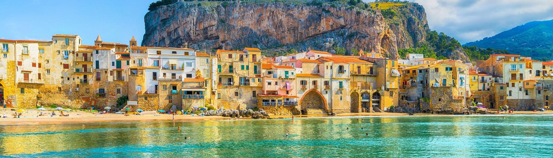 During a boat trip in Cefalù, Sicily, you can admire the mediaval village from the water.
