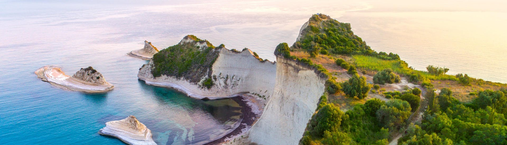 An image of beautiful Cape Drastis, one of the places one might visit on a boat trip in Corfu.