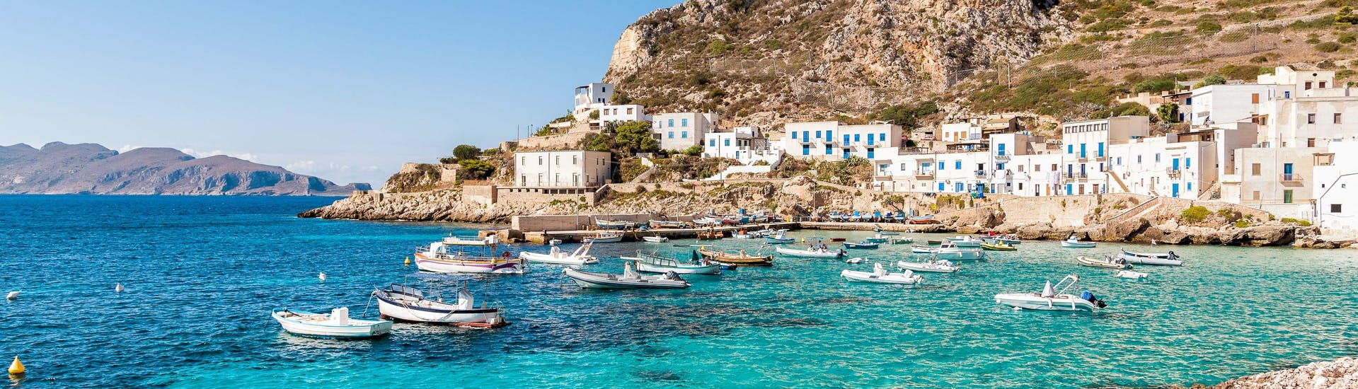 A view of the coastline of the island of Levanzo that visitors can see on a boat trip to the Egadi Islands in Sicily.