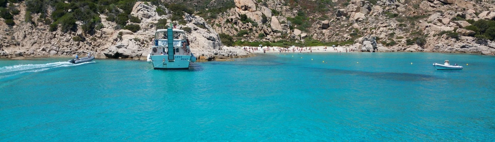The Lady Luna 2 Palau boat has anchored in a beautiful bay with turquoise water during the Boat Trip from Palau to La Maddalena Archipelago -Low Season.