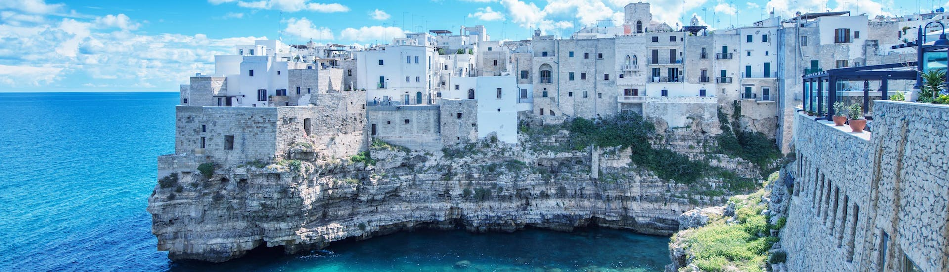 An image of the turquoise waters around Polignano a Mare that visitors get to witness on a boat trip in Puglia.