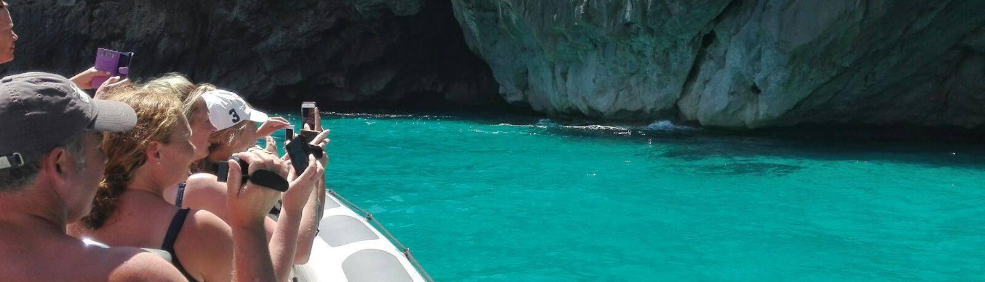 The tour participants enjoy the view of the crystal clear water and stone cliffs during the Boat Trip to Cabo Formentor with Dolphin Watching with Alcúdia Sea Explorer.
