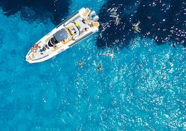 One of our boats sailing on the blue waters during the boat tour to Favignana and Levanzo with snorkeling with Mare and More Tour Trapani.