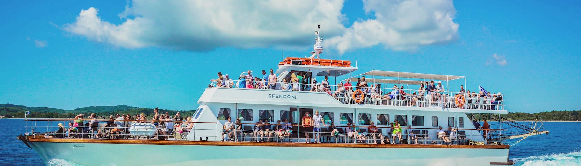 People on a boat during their during the boat trip to Paxos & Antipaxos with Blue Caves from Corfu with Ionian Cruises.
