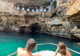 A couple during the boat trip to Polignano a Mare caves with aperitif with Pugliamare.