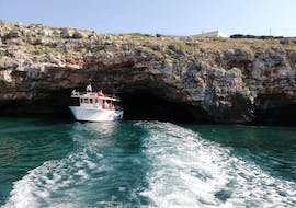 One of the boats from Noleggio Nettuno Torre Vado visiting a cave during the boat trip to the Salento Caved with aperitif.