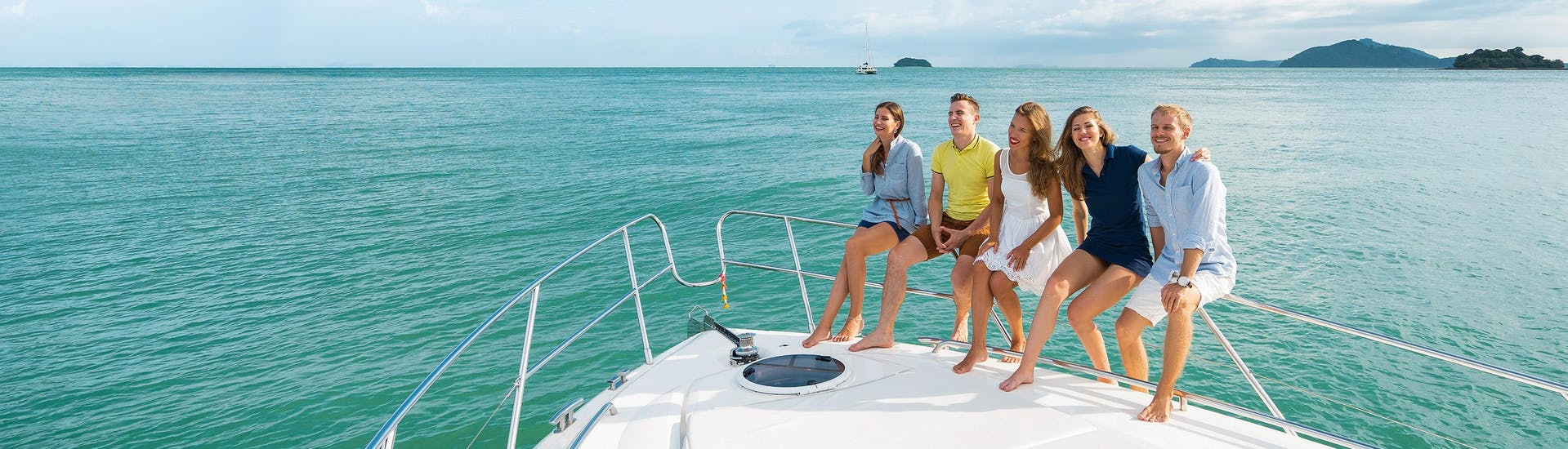 A group of friends relaxing on a boat trip in the holiday destination of Queensland.