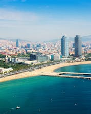 An aerial view of Playa de la Barceloneta, a popular place for boat trips in Barcelona.