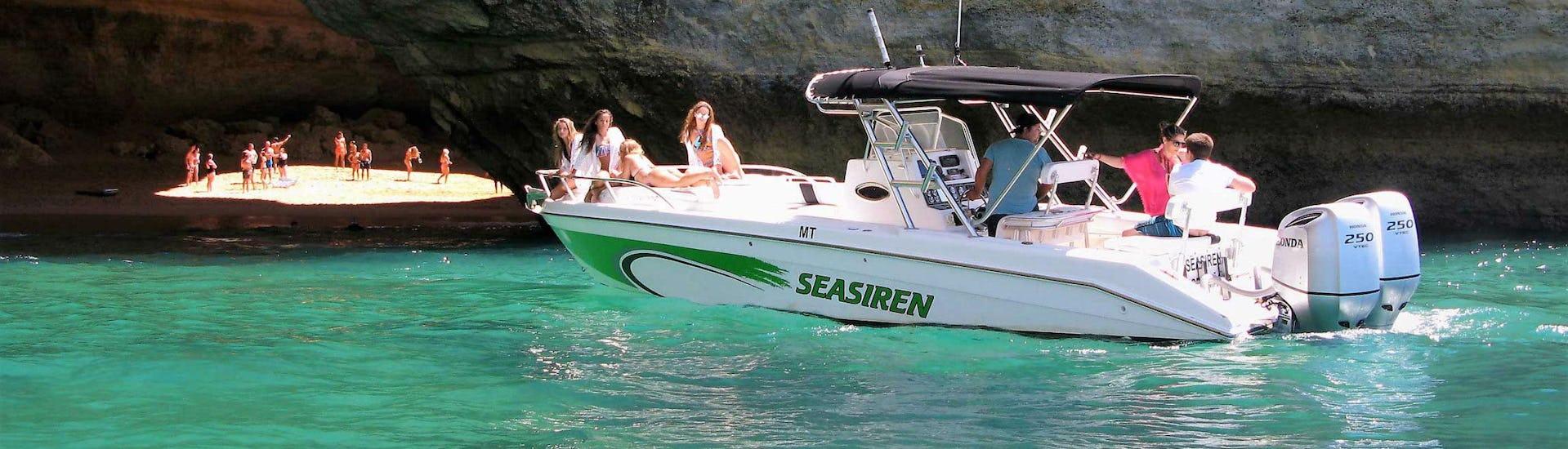 The Seasiren Tours motor boat is approaching the Benagil Cave during the Boat Tour - Benagil Cave.