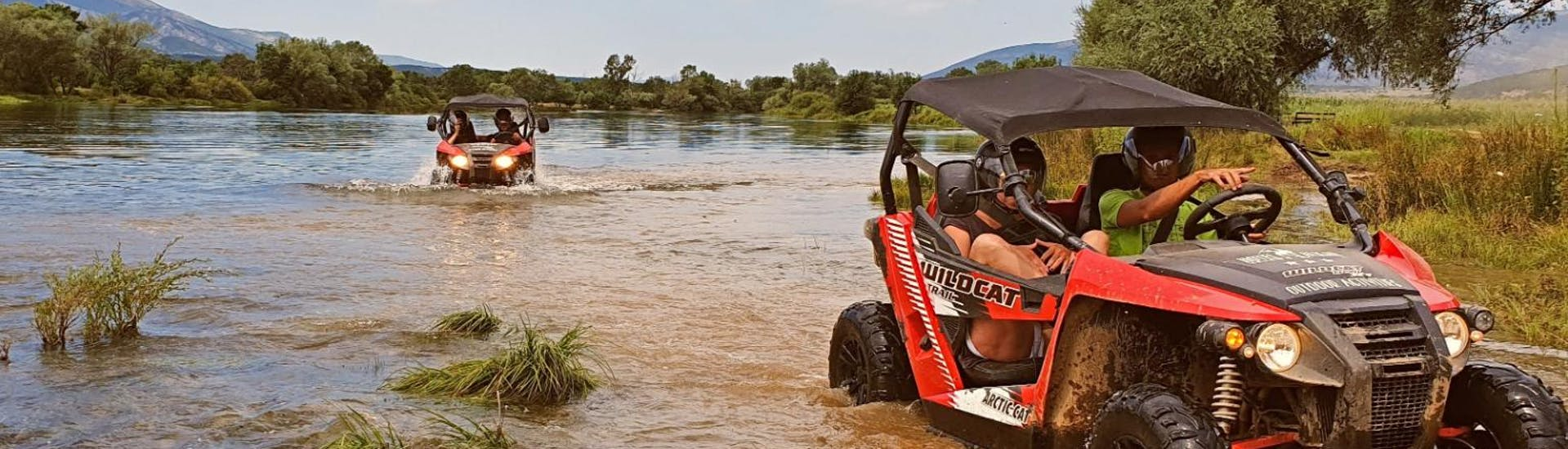 Participants of Cetina River Extreme Buggy Tour from Sinj organised by Hotel Alkar are driving through a river.