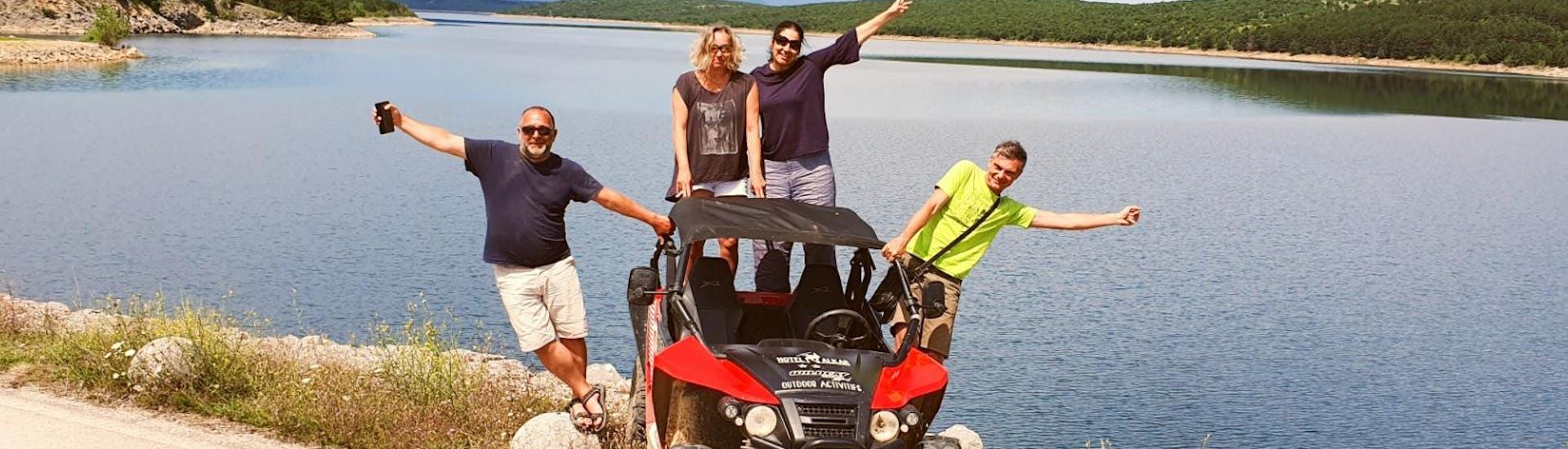 Happy participants of the Fun Buggy Tour from Sinj are posing for a photo taken by a local guide from Hotel Alkar.