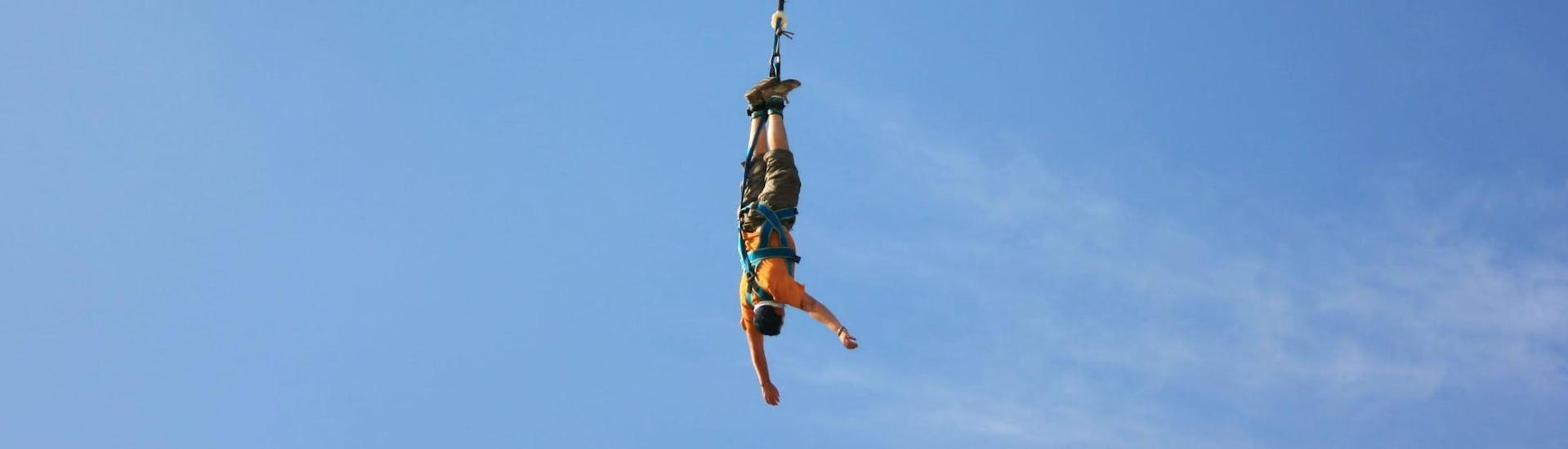 A person is participating to the Bungee Jumping from Viaduc de Coquilleau (52m) activity with Elastic Crocodil Bungee.
