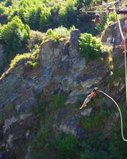 A brave young man is leaping into the depths of the canyon while bungee jumping at Gorges du Tarn.
