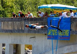A person is bungee jumping from the Pont de l'Artuby, the highest bridge in France with a 182m height with Latitude Challenge.