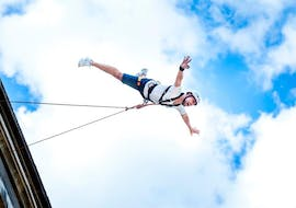 A man enjoys the free fall during the Bungee Jumping in Murillo de Gállego (25m), organized by UR Pirineos