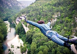 "A man is jumping during his Bungee Jumping ""Le 107"" in Gorges du Tarn (107m) with Elastic Natural Bungee."