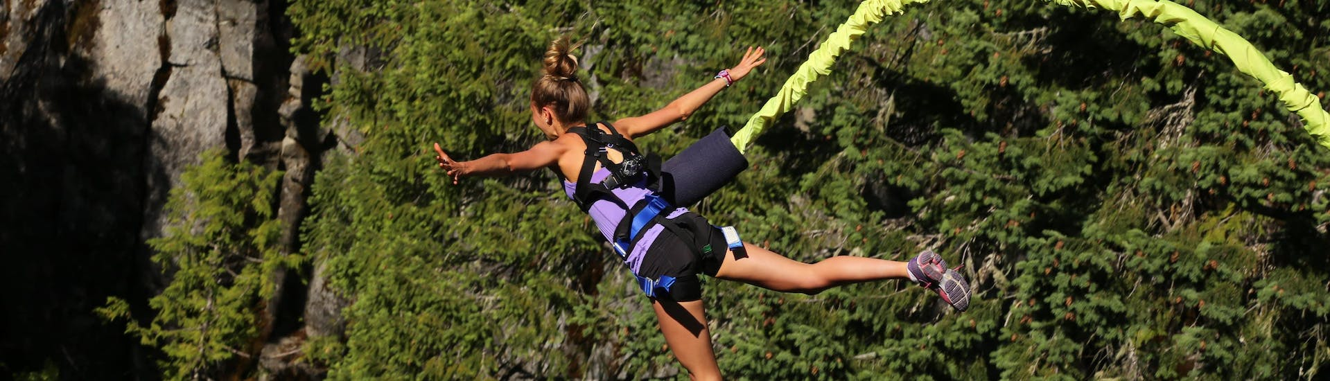 A young woman bungee jumping close to the bungee jumping hotspot of Spain.