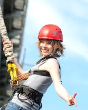 A woman smiling before doing her bungee jumping in Galicia.