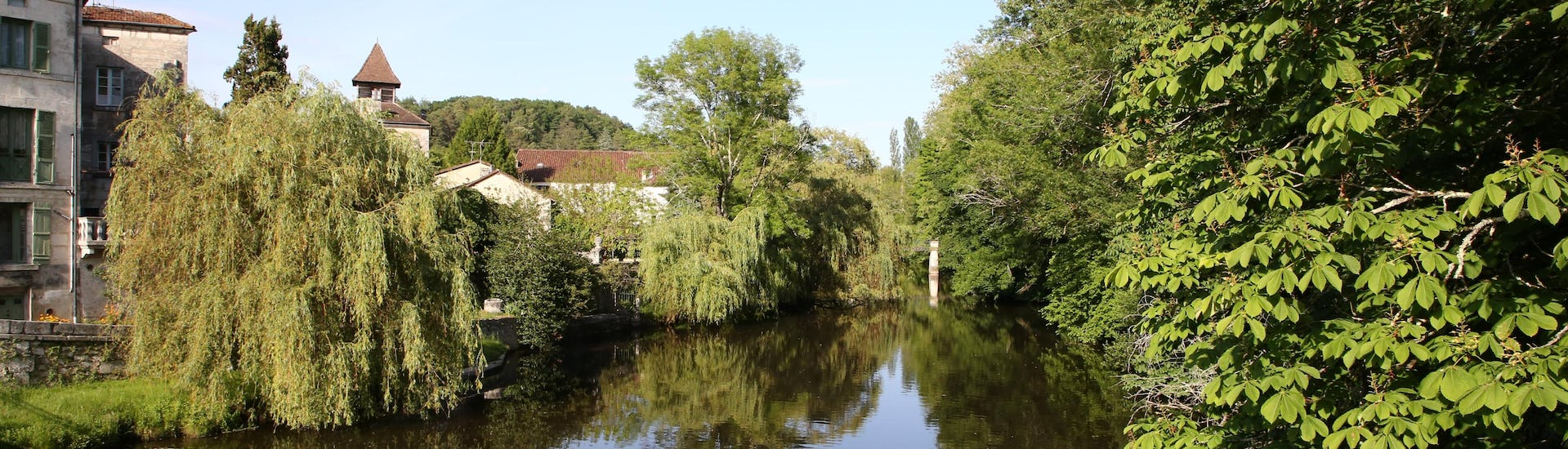 Bucolic view of the Dronne, a river in the Dordogne, in the Périgord vert, where it is possible to do canoeing.
