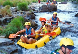 While Canoeing on Rio Paiva in Arouca Geopark with Clube do Paiva, a family of three is having fun as they paddle through a splashing rapid.
