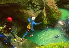 A participant of the Canyoning Adventure in Triglav National Park with 3glav Adventure is jumping into a natural pool.