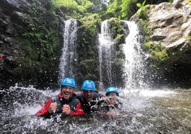 """The participants of the Canyoning """"Adventure"""" in Salto do Cabrito which is organized by Azores Epic Adventures are having fun while splashing water in the canyon."""