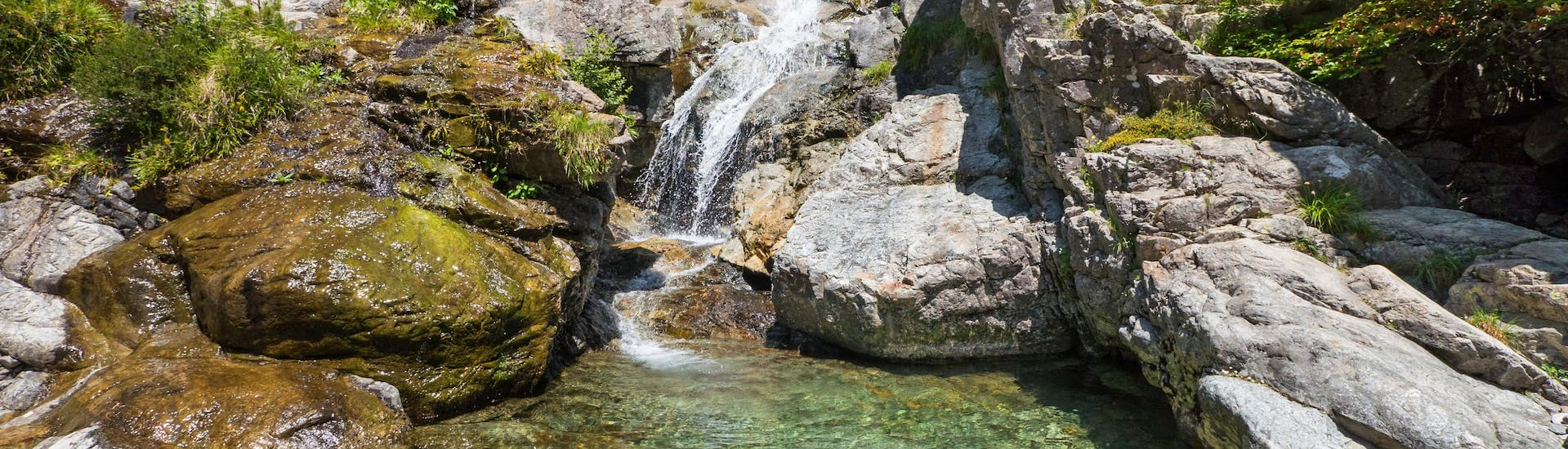 An image of the Cascade des Anglais waterfall, an impressive sight one might get to see when canyoning near Ajaccio.